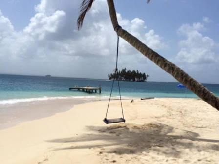 Swing in a palmtree on a tropical beach in the islands of San Blas in Panama