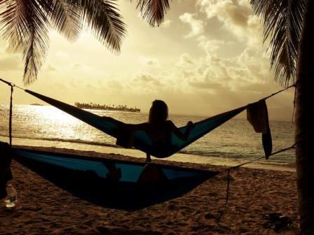 Relaxing in a hammock at sunset in the islands of San Blas of Panama